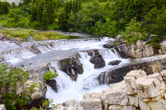 Cascading Water on Swiftcurrent Creek Stock Photos