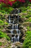 Cascading waterfall. In japanese garden in springtime stock photo