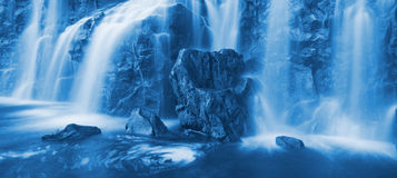 Cascading Waterfall. Panorama of Cascading Waterfall, Blue Water Flows over Natural Rocks royalty free stock photography