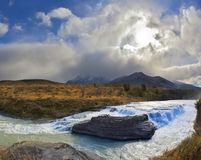 The cascading waterfall and  billowing clouds Stock Photos