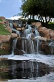 Cascading Waterfall blurred water with reflection. Cascading waterfall in Arizona beautiful reflection on hillside Stock Image