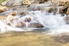 Cascading waterfall closeup very smooth water with wet rocks Stock Photos