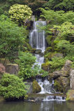 Cascading waterfall in japanese garden in portland stock photo