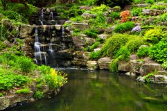 Cascading waterfall and pond. In japanese garden royalty free stock photography