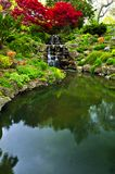 Cascading waterfall and pond stock images