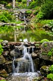 Cascading waterfall and pond. In japanese garden royalty free stock image