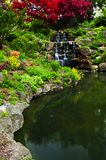 Cascading waterfall and pond. In japanese garden royalty free stock photo