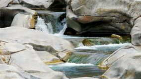 Cascading Waterfalls over Rocks in forest landscape