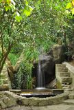 Cascading waterfalls among the stones in the summer Green Park. Crimea Ukraine stock image
