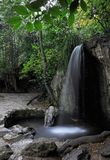 Cascading waterfalls among the stones in the summer Green Park. Crimea Ukraine stock photography