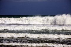 Cascading waves on beach in Bali, Indonesia Royalty Free Stock Photo