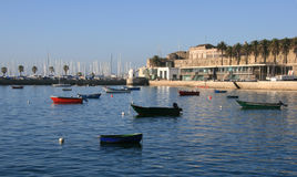 Cascais. Boats on a small harbor in cascais in Portugal. The fortress is also here royalty free stock photo