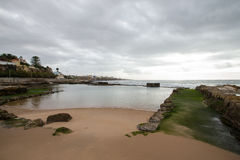 Cascais embankment at low tide. dramatically Stock Photo