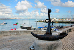 Cascais marina. A big anchor on the boardwalk with Royalty Free Stock Images
