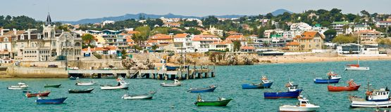 Cascais, Portugal. Panoramic view of Cascais harbour with fishing boats in the foreground stock photography