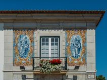 Balcony with blue azulejo tiles depicting religious imagery on facade of Town Hall in Cascais, a little village located in the wes. Cascais, Portugal - August 24 royalty free stock photography