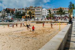 Men play variation between beach volley and beach football known as Futevolei on a beach in Cascais, Portugal. This