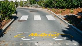 Entrance to an empty McDrive drive-thru at a McDonald`s fast-food restaurant royalty free stock photo