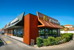 Outside view of facade of modern McDonald`s fast-food restaurant with drive-thru. Cascais, Portugal - May 31, 2019: Outside view of facade of modern McDonald`s stock image