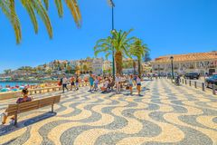 Cascais waterfront promenade. Cascais, Portugal - August 6, 2017: promenade along Ribeira beach on Passeio Dom Luis I street. Cascais is popular summer vacation royalty free stock photography