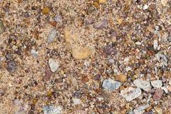 Cascalho com a areia como o fundo Fotografia de Stock Royalty Free