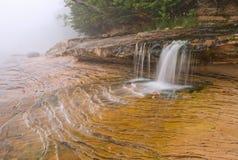 Cascata da praia do mineiro na névoa Fotos de Stock Royalty Free