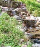 Cascata de cachoeiras artificiais Imagens de Stock