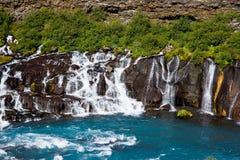 Cascata di Hraunfossar in Islanda Immagini Stock Libere da Diritti