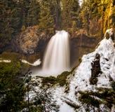 Cascata di inverno in foresta Immagine Stock Libera da Diritti