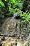 Cascata in montagna della gola del Guam, regione di Krasnodar Fotografie Stock