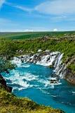 Cascate di Hraunfossar in Islanda Fotografia Stock Libera da Diritti