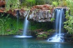 Cascate a Fern Pool nel parco nazionale di Karijini, Australia fotografia stock libera da diritti