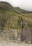 Cascate vicino al ghiacciaio di Fox in Nuova Zelanda Immagini Stock