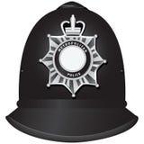 Casco británico de los oficiales de policía Imagenes de archivo