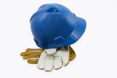 Casco de protección y guantes Fotografía de archivo libre de regalías