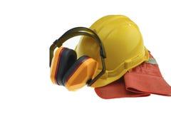 Casco de seguridad y guantes y orejeras Fotos de archivo libres de regalías