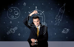 Casco del dibujo de la persona de las ventas y cohete de espacio Imagenes de archivo