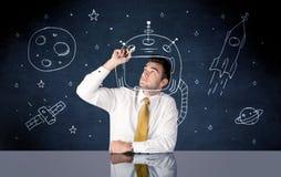 Casco del dibujo de la persona de las ventas y cohete de espacio Fotografía de archivo libre de regalías