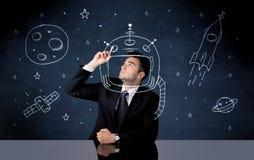 Casco del dibujo de la persona de las ventas y cohete de espacio Imágenes de archivo libres de regalías