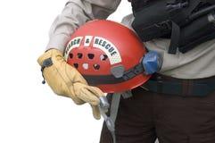 Casco della holding del soccorritore Immagini Stock Libere da Diritti