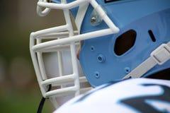 Casco di gioco del calcio e maschera di protezione   Fotografie Stock