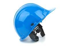 Casco di sicurezza blu sui precedenti bianchi Fotografia Stock