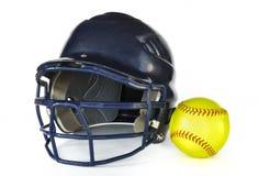 Casco e softball giallo Fotografie Stock