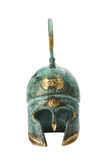 Casco griego de cobre amarillo antiguo del recuerdo sobre blanco Fotografía de archivo libre de regalías