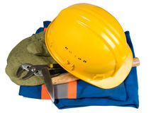 Casco, guanti, strumento e vestiti gialli fotografia stock libera da diritti