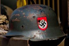 Casco nazi en el jeep americano Imagen de archivo libre de regalías