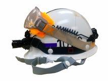 Casco sui precedenti bianchi, PPE, dispositivi di protezione individuale Immagini Stock
