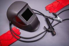 Casco y guantes para soldar con autógena Fotografía de archivo libre de regalías