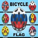 Cascos de la bicicleta de los iconos y países de las banderas Imagen de archivo libre de regalías