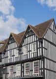 Case armate in legno in bianco e nero in Stratford Upon immagini stock
